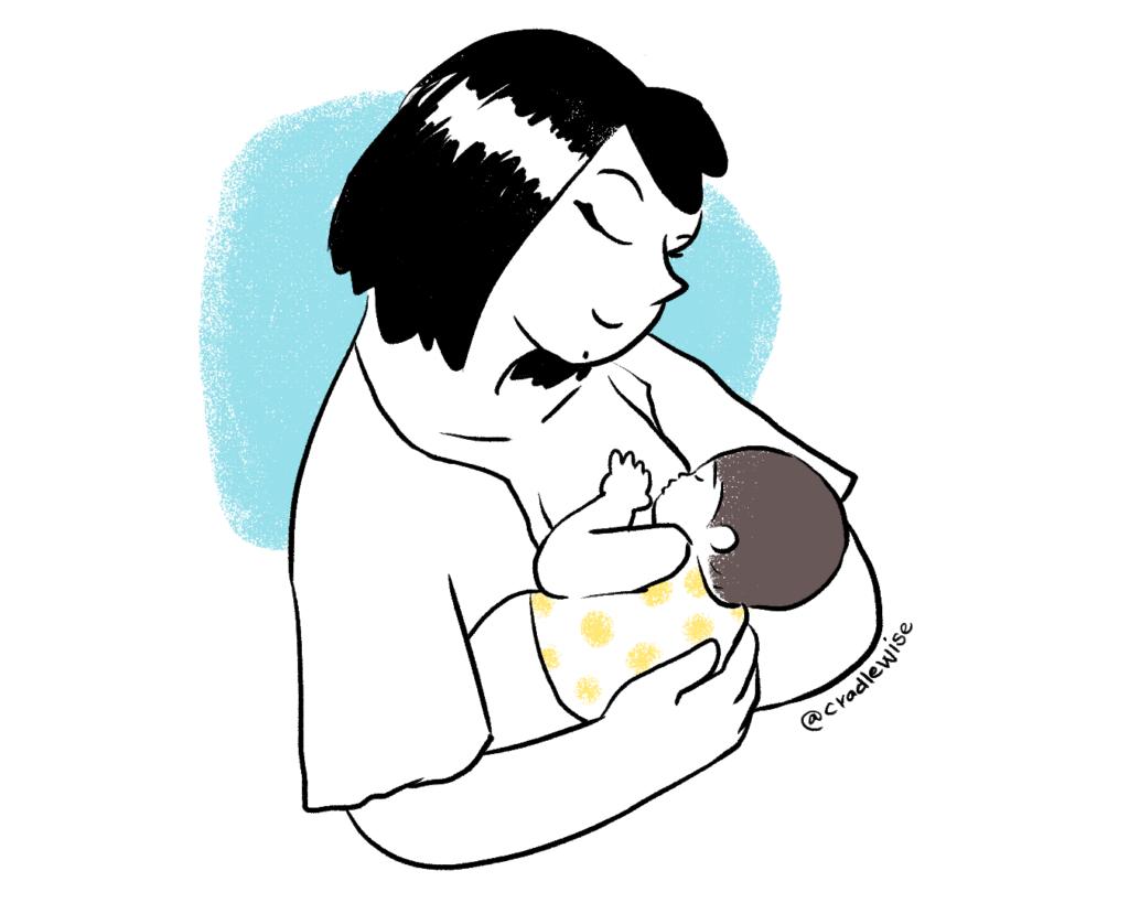 Breastfeeding mom holding the baby