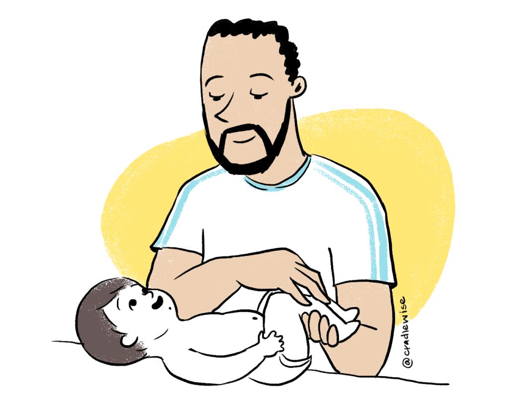 Dad massages baby and enhances bond